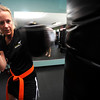 """Jill Turner works on a bag during a kickboxing class at itsera Family Fitness in Niwot on Thursday August 11, 2011.<br /> For more photos and a video from the class go to  <a href=""""http://www.dailycamera.com"""">http://www.dailycamera.com</a><br /> Photo by Paul Aiken  August 11, 2011."""