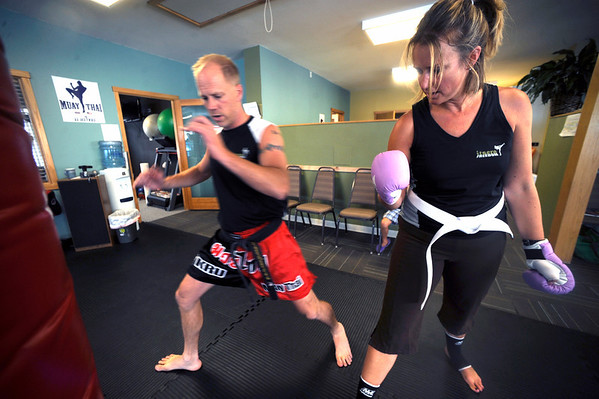 "Owner and Instructor Scott Meier works with Tara Rathburn during a kickboxing class at itsera Family Fitness in Niwot on Thursday August 11, 2011.<br /> For more photos and a video from the class go to  <a href=""http://www.dailycamera.com"">http://www.dailycamera.com</a><br /> Photo by Paul Aiken  August 11, 2011."
