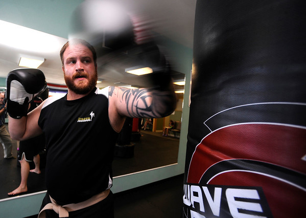 """Jamie Maples works on his backfist during a kickboxing class at itsera Family Fitness in Niwot on Thursday August 11, 2011.<br /> For more photos and a video from the class go to  <a href=""""http://www.dailycamera.com"""">http://www.dailycamera.com</a><br /> Photo by Paul Aiken  August 11, 2011."""