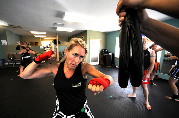 "Anne McCullick Owner and Instructor performs some speed bag work  during a kickboxing class at itsera Family Fitness in Niwot on Thursday August 11, 2011.<br /> For more photos and a video from the class go to  <a href=""http://www.dailycamera.com"">http://www.dailycamera.com</a><br /> Photo by Paul Aiken  August 11, 2011."