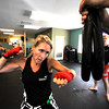 """Anne McCullick Owner and Instructor performs some speed bag work  during a kickboxing class at itsera Family Fitness in Niwot on Thursday August 11, 2011.<br /> For more photos and a video from the class go to  <a href=""""http://www.dailycamera.com"""">http://www.dailycamera.com</a><br /> Photo by Paul Aiken  August 11, 2011."""