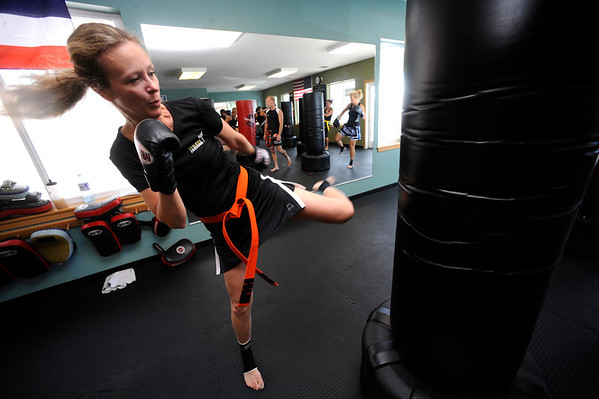 "Jill Turner works on a bag during a kickboxing class at itsera Family Fitness in Niwot on Thursday August 11, 2011.<br /> For more photos and a video from the class go to  <a href=""http://www.dailycamera.com"">http://www.dailycamera.com</a><br /> Photo by Paul Aiken  August 11, 2011."