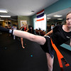 "Jill Turner performs a kick during a kickboxing class at itsera Family Fitness in Niwot on Thursday August 11, 2011.<br /> For more photos and a video from the class go to  <a href=""http://www.dailycamera.com"">http://www.dailycamera.com</a><br /> Photo by Paul Aiken  August 11, 2011."