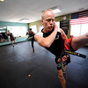 "Owner and Instructor Scott Meier demontrates a kick during a kickboxing class at itsera Family Fitness in Niwot on Thursday August 11, 2011.<br /> For more photos and a video from the class go to  <a href=""http://www.dailycamera.com"">http://www.dailycamera.com</a><br /> Photo by Paul Aiken  August 11, 2011."