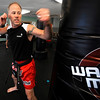 "Owner and Instructor Scott Meier demonstrates a backfist sequence during a kickboxing class at itsera Family Fitness in Niwot on Thursday August 11, 2011.<br /> For more photos and a video from the class go to  <a href=""http://www.dailycamera.com"">http://www.dailycamera.com</a><br /> Photo by Paul Aiken  August 11, 2011."