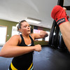 "Jessica Hamlin works on a speed bag during a kickboxing class at itsera Family Fitness in Niwot on Thursday August 11, 2011.<br /> For more photos and a video from the class go to  <a href=""http://www.dailycamera.com"">http://www.dailycamera.com</a><br /> Photo by Paul Aiken  August 11, 2011."