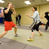 Mike Welsh, left and Heather Underwood spar at the Colorado Krav Maga Regional Training Center in Broomfield on Wednesday.