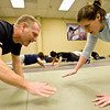 Mike Welsh, left and Heather Underwood train at the Colorado Krav Maga Regional Training Center in Broomfield on Wednesday.
