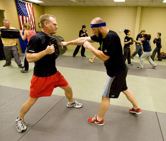 Mike Welsh, left, and Neil Paschal train at the Colorado Krav Maga Regional Training Center in Broomfield on Wednesday.