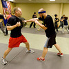 Maga4.jpg Mike Welsh, left, and Neil Paschal train at the Colorado Krav Maga Regional Training Center in Broomfield on Wednesday.