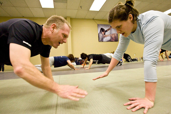 Maga3.jpg Mike Welsh, left and Heather Underwood train at the Colorado Krav Maga Regional Training Center in Broomfield on Wednesday.