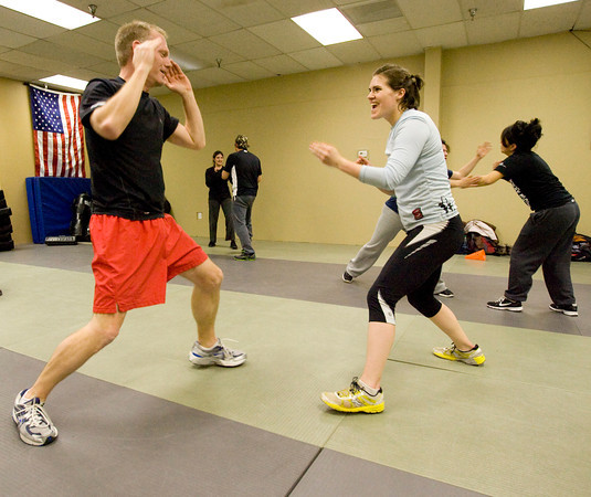 Maga2.jpg Mike Welsh, left and Heather Underwood spar at the Colorado Krav Maga Regional Training Center in Broomfield on Wednesday.