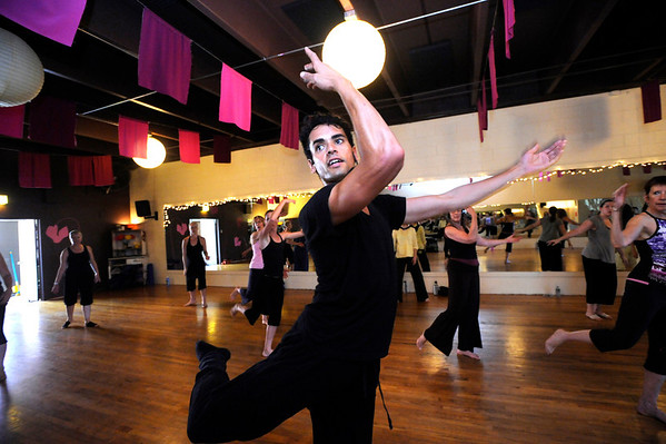 """Instuctor John Corsa leads a class in the Contemporary Modern Dance class at the Alchemy of Movement dance studio on Wednesday morning. <br /> For more photos and a video of the class go to  <a href=""""http://www.dailycamera.com"""">http://www.dailycamera.com</a><br /> Photo by Paul Aiken  August 3, 2011."""