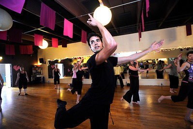 Instuctor John Corsa leads a class in the Contemporary Modern Dance class at the Alchemy of Movement dance studio on Wednesday morning.  For more photos and a video of the class go to www.dailycamera.com Photo by Paul Aiken  August 3, 2011.