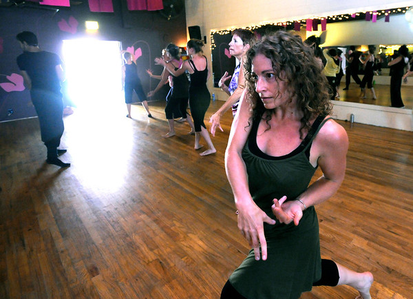 """Deanna Gariel works on a series of dance moves in the Contemporary Modern Dance class at the Alchemy of Movement dance studio on Wednesday morning. <br /> For more photos and a video of the class go to  <a href=""""http://www.dailycamera.com"""">http://www.dailycamera.com</a><br /> Photo by Paul Aiken  August 3, 2011."""
