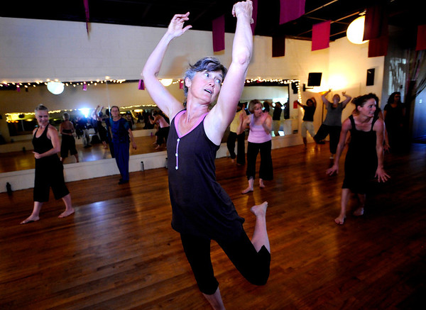 "Lauren Culbertson works on learning a series of dance moves in the Contemporary Modern Dance class at the Alchemy of Movement dance studio on Wednesday morning. <br /> For more photos and a video of the class go to  <a href=""http://www.dailycamera.com"">http://www.dailycamera.com</a><br /> Photo by Paul Aiken  August 3, 2011."