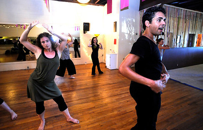 Instuctor John Corsa leads a class in the Contemporary Modern Dance class at the Alchemy of Movement dance studio on Wednesday morning. Following Corsa's directions at left is Deanna Gabriel. For more photos and a video of the class go to www.dailycamera.com Photo by Paul Aiken  August 3, 2011.