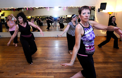 Cindy Morris, left front and Lynn VanDemark, front right, practice a series of dance moves in the Contemporary Modern Dance class at the Alchemy of Movement dance studio on Wednesday morning.  For more photos and a video of the class go to www.dailycamera.com Photo by Paul Aiken  August 3, 2011.