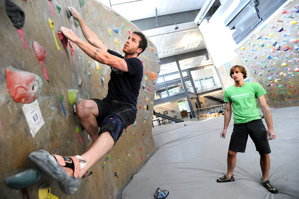 """Instructor Drew Heckman watches Kris Peters work on a climbing exercise during the Movement 101 class at Movement Climbing + Fitness in Boulder on Tuesday April 10, 2012<br /> For more photos and a video of class  go to  <a href=""""http://www.daliycamera.com"""">http://www.daliycamera.com</a><br /> April 10, 2012.<br /> Photo by Paul Aiken / The Camera"""