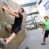 "Instructor Drew Heckman watches Kris Peters work on a climbing exercise during the Movement 101 class at Movement Climbing + Fitness in Boulder on Tuesday April 10, 2012<br /> For more photos and a video of class  go to  <a href=""http://www.daliycamera.com"">http://www.daliycamera.com</a><br /> April 10, 2012.<br /> Photo by Paul Aiken / The Camera"