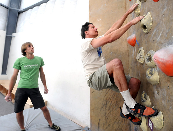 """Instructor Drew Heckman watches Mark Hanna work on a climbing exercise during the Movement 101 class at Movement Climbing + Fitness in Boulder on Tuesday April 10, 2012<br /> For more photos and a video of class  go to  <a href=""""http://www.daliycamera.com"""">http://www.daliycamera.com</a><br /> April 10, 2012.<br /> Photo by Paul Aiken / The Camera"""