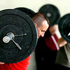 Class members clean and jerk at their own pace.<br /> A class of Olympic weight lifting was taught at CrossFit in Boulder by David Miller and Randy Hauer.<br /> Cliff Grassmick / November 21, 2009