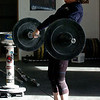 "Olympian Carissa Gump shows her form for the class.<br /> A class of Olympic weight lifting was taught at CrossFit in Boulder by David Miller and Randy Hauer.For more photos and a video of the workout, go to  <a href=""http://www.dailycamera.com"">http://www.dailycamera.com</a>.<br /> Cliff Grassmick / November 21, 2009"