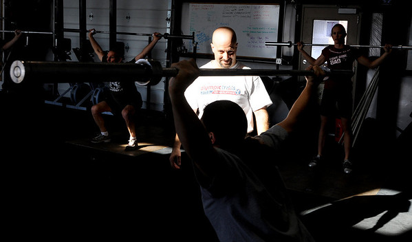 Instructor David Miller explains the proper form to use.<br /> A class of Olympic weight lifting was taught at CrossFit in Boulder by David Miller and Randy Hauer.<br /> Cliff Grassmick / November 21, 2009