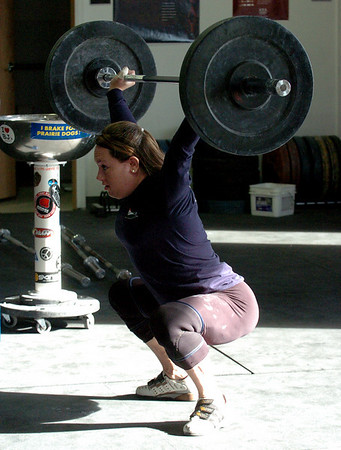 "Olympian Carissa Gump shows her form for the class.<br /> A class of Olympic weight lifting was taught at CrossFit in Boulder by David Miller and Randy Hauer. For more photos and a video of the workout, go to  <a href=""http://www.dailycamera.com"">http://www.dailycamera.com</a>.<br /> Cliff Grassmick / November 21, 2009"