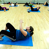 "Instructor Natalie Lovstedt leads her class through an abdominal workout during the Power of Three class at the St.Vrain Memorial Building in Longmont on Wednesday December 21, 2011. For a video and more photos from the class go to  <a href=""http://www.dailycamera.com"">http://www.dailycamera.com</a>.<br /> Photo by Paul Aiken"