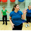 """Instructor Natalie Lovstedt leads Judy Reich, back left and Roni Kopetzky in some dance moves during the Power of Three class at the St.Vrain Memorial Building in Longmont on Wednesday December 21, 2011. For a video and more photos from the class go to  <a href=""""http://www.dailycamera.com"""">http://www.dailycamera.com</a>.<br /> Photo by Paul Aiken"""