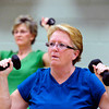 "Judy Reich, left and Roni Kopetzky lift weights during the Power of Three class at the St.Vrain Memorial Building in Longmont on Wednesday December 21, 2011. For a video and more photos from the class go to  <a href=""http://www.dailycamera.com"">http://www.dailycamera.com</a>.<br /> Photo by Paul Aiken"