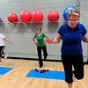 "From left to right Nicole Donohue, Judy Reich and Roni Kopetzky. work on a balance move with weights during the Power of Three class at the St.Vrain Memorial Building in Longmont on Wednesday December 21, 2011. For a video and more photos from the class go to  <a href=""http://www.dailycamera.com"">http://www.dailycamera.com</a>.<br /> Photo by Paul Aiken"