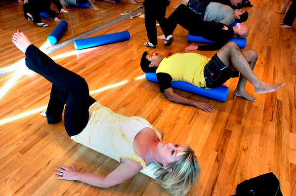 """Stacie Pine, left, and Ganesh Krishnan work on a core leg raising exercise during a pilates seminar for barefoot or minimal runners at the Pat Guyton Pilates in Boulder on Sunday January 10, 2010.  For more photos of the workout of the week go to  <a href=""""http://www.dailycamera.com"""">http://www.dailycamera.com</a>.<br /> Photo by Paul Aiken / The Boulder Camera / January 10, 2010"""
