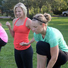 "Instructor Linzee Klinkenberg, left,  is pleased with the form of Lesley Wujastyk during class.<br /> Linzee Klinkenberg teaches a PowerFit Yoga class at Chautauqua Park in Boulder, CO on August 9, 2012.<br /> For a video and more photos of PowerFit Yoga, go to  <a href=""http://www.dailycamera.com"">http://www.dailycamera.com</a><br /> Cliff Grassmick  / August 9, 2012"