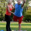 "Linzee Klinkenberg  helps Andy Bachmann with his form during class.<br /> Linzee Klinkenberg teaches a PowerFit Yoga class at Chautauqua Park in Boulder, CO on August 9, 2012.<br /> For a video and more photos of PowerFit Yoga, go to  <a href=""http://www.dailycamera.com"">http://www.dailycamera.com</a><br /> Cliff Grassmick  / August 9, 2012"