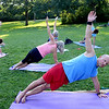 "Andy Bachmann, front, works out in a PowerFit Yoga class at Chautauqua.<br /> Linzee Klinkenberg teaches a PowerFit Yoga class at Chautauqua Park in Boulder, CO on August 9, 2012.<br /> For a video and more photos of PowerFit Yoga, go to  <a href=""http://www.dailycamera.com"">http://www.dailycamera.com</a><br /> Cliff Grassmick  / August 9, 2012"