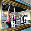 "Instructor Jessica King, left, leads her class during a Reflective Frequency Yoga class on Thursday, Jan. 24, at Sangha Studios on Front Street in Louisville. For a video about the yoga class go to  <a href=""http://www.dailycamera.com"">http://www.dailycamera.com</a> <br /> Jeremy Papasso/ Camera"