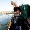"Coxswain Susan Anthes prepares the sound system for the row boat to be used for the novice rowers at the Boulder Reservoir on Friday.<br /> For a video and more photos of the rowing class, go to  <a href=""http://www.dailycamera.com"">http://www.dailycamera.com</a><br /> Cliff Grassmick / June 22, 2012"