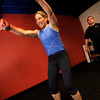 "Karie Kerner, works on band exercise for the arms as Glenn Marshman looks on in the Functional Fitness Small Group Training at One Boulder Fitness.  For more photos and a video of the class go to  <a href=""http://www.dailycamera.com"">http://www.dailycamera.com</a>.<br /> Photo by Paul Aiken / October 13, 2001..."