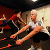 "Karie Kerner,, reporter Aimee Heckel and Donna Jobert,  work a resistance squat exercise in the Functional Fitness Small Group Training at One Boulder Fitness.  For more photos and a video of the class go to  <a href=""http://www.dailycamera.com"">http://www.dailycamera.com</a>.<br /> Photo by Paul Aiken / October 13, 2001..."