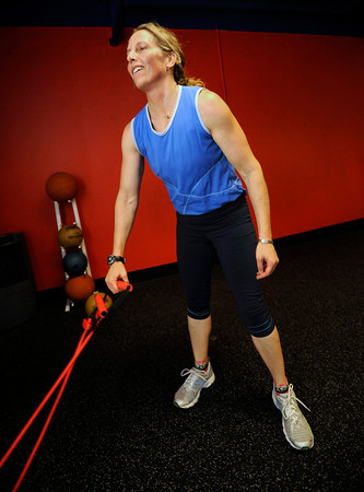 "Karie Kerner, staggers after finishing a leg exercise in the Functional Fitness Small Group Training at One Boulder Fitness.  For more photos and a video of the class go to  <a href=""http://www.dailycamera.com"">http://www.dailycamera.com</a>.<br /> Photo by Paul Aiken / October 13, 2001..."