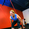 "Karie Kerner, works a pull down exericse with resistance bands in the Functional Fitness Small Group Training at One Boulder Fitness.  For more photos and a video of the class go to  <a href=""http://www.dailycamera.com"">http://www.dailycamera.com</a>.<br /> Photo by Paul Aiken / October 13, 2001..."