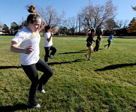 """Caitlin Marahan, left, joins others in a boot camp ski conditioning class run by Annette Bray at Scott Carpenter Park in Boulder.<br /> For a video and more photos of the workout, go to  <a href=""""http://www.dailycamera.com"""">http://www.dailycamera.com</a>.<br /> Cliff Grassmick  / November 7, 2012"""