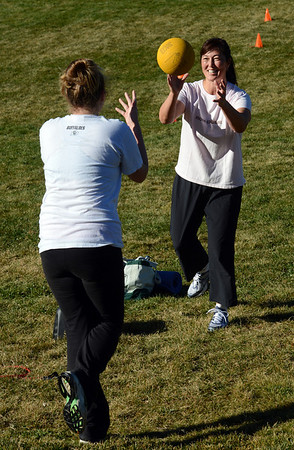 "Caitlin Marahan, left, and Victoria Gagner, work out with a ball during a boot camp ski conditioning class run by Annette Bray at Scott Carpenter Park in Boulder.<br /> For a video and more photos of the workout, go to  <a href=""http://www.dailycamera.com"">http://www.dailycamera.com</a>.<br /> Cliff Grassmick  / November 7, 2012"