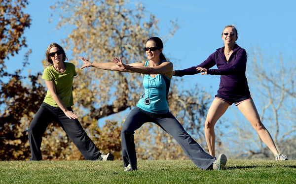 "Annette Bray, center, leads the group in a boot camp ski conditioning class at Scott Carpenter Park in Boulder.<br /> For a video and more photos of the workout, go to  <a href=""http://www.dailycamera.com"">http://www.dailycamera.com</a>.<br /> Cliff Grassmick  / November 7, 2012"