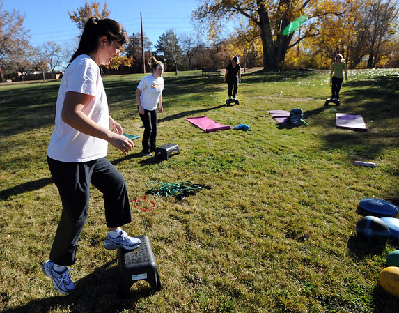 "Victoria Gagner, left, joins others in a boot camp ski conditioning class run by Annette Bray at Scott Carpenter Park in Boulder.<br /> For a video and more photos of the workout, go to  <a href=""http://www.dailycamera.com"">http://www.dailycamera.com</a>.<br /> Cliff Grassmick  / November 7, 2012"