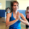 "Instructor Dana Bennett uses a yoga pose to work out on Thursday, Jan. 19, during a Sole Control workout at the Lakeshore Athletic Club in Broomfield. For more photos and video of the workout go to  <a href=""http://www.dailycamera.com"">http://www.dailycamera.com</a><br />  Jeremy Papasso/ Camera"