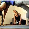 Andrea Flanagan watches as her instructor, Ashley Quinn, eases into the Bridge position during a Spontaneous Yoga class held in Quinn's apartment in Boulder on Tuesday, September 4, 2012. Jessica Cuneo/ For the Daily Camera.