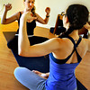 Andrea Flanagan, left, stretches with her instructor Ashley Quinn during a Spontaneous Yoga class held in Quinn's apartment in Boulder on Tuesday, September 4, 2012. Jessica Cuneo/ For the Daily Camera.
